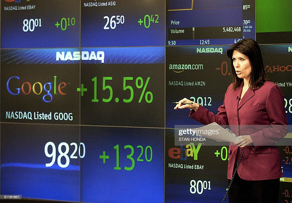 Brazilian television reporter Daniela Schneider delivers her report in front of a graphic of the Google stock price listing after trading started, 19 August, 2004, on the Nasdaq stock exchange in New York. Google, making the biggest Internet float since the 1990s technology bubble, opened at 100.01 USD. Within an hour, more than 12 million shares had changed hands. The world's leading Internet search engine spiked to 103.42 USD and was trading early afternoon at 103.15 USD, valuing the entire company at 28 billion dollars. AFP PHOTO/Stan HONDA