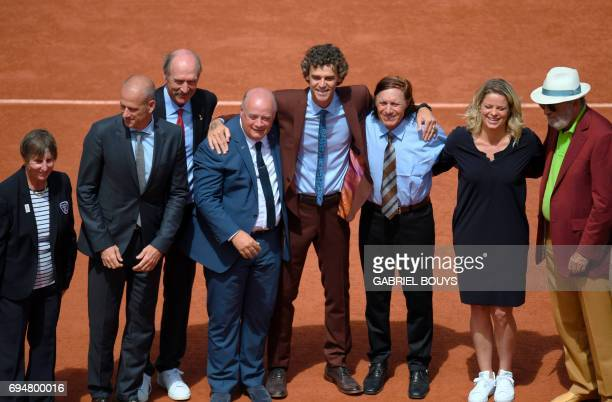 CORRECTION Brazilian tennis player Gustavo Kuerten poses with Romanian former player Ion Tiriac former Belgian tennis player Argentina's former...