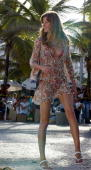 Brazilian Top Model Gisele Bundchen poses on the beaches of Ipanema during the taping of a TV commercial to promote the launching of sandals bearing...