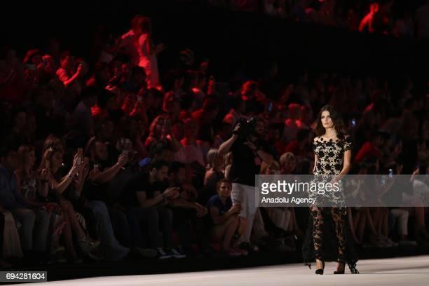 Brazilian top model Isabeli Fontana walks the runway during the Dosso Dossi Fashion Show in Antalya Turkey on June 09 2017