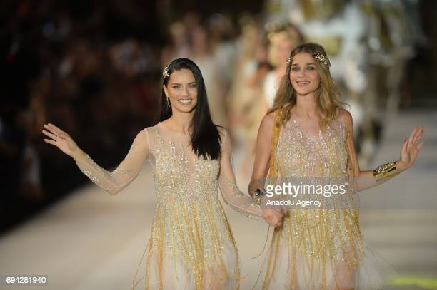 Brazilian top models Adriana Lima and Ana Beatriz Barros salute the people as they walk the runway during the Dosso Dossi Fashion Show in Antalya...