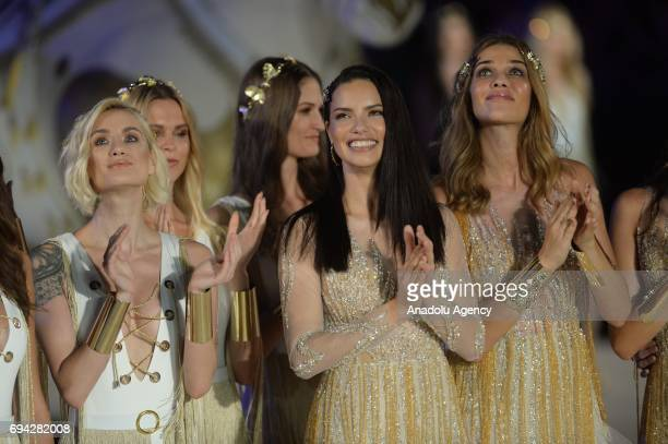 Brazilian top models Adriana Lima salutes the people as they walk the runway during the Dosso Dossi Fashion Show in Antalya Turkey on June 09 2017