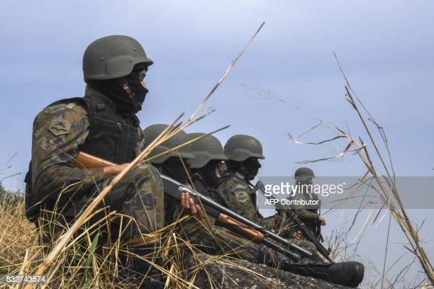 Brazilian troops in full combat gear occupy high ground during a predawn antigang operation in Niteroi greater Rio de Janeiro Brazil on August 16...