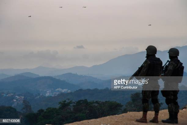 Brazilian troops occupy the top of a hill during a predawn antigang operation in Niteroi greater Rio de Janeiro Brazil on August 16 2017 Police...