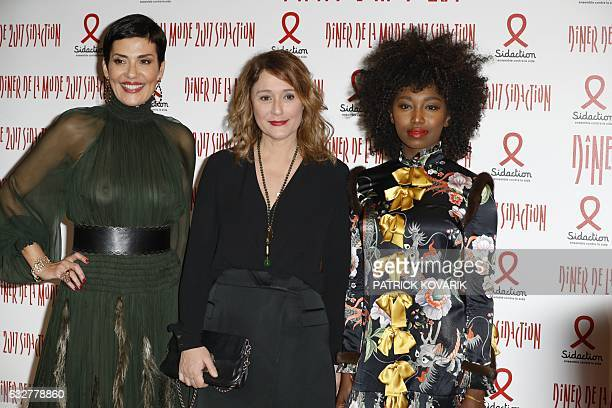 Brazilian TV host Cristina Cordula French TV host Daniela Lumbroso and Malian singer Inna Modja poses during a photocall upon arriving to attend the...