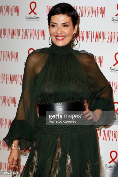 Brazilian TV host Cristina Cordula poses upon arriving to attend the Diner de la Mode fundraiser dinner in profit of French antiAIDS association...