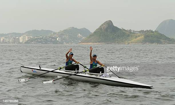 Brazilian twin sisters Claudia and Katia Alencar former members of Brazil's rowing team arrive on their double scull boat at Guanabara Bay in Rio de...
