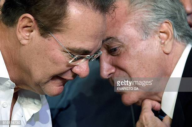 Brazilian Vice President Michel Temer speaks with the president of the Senate Renan Calheiros during the Brazilian Democratic Movement Party national...
