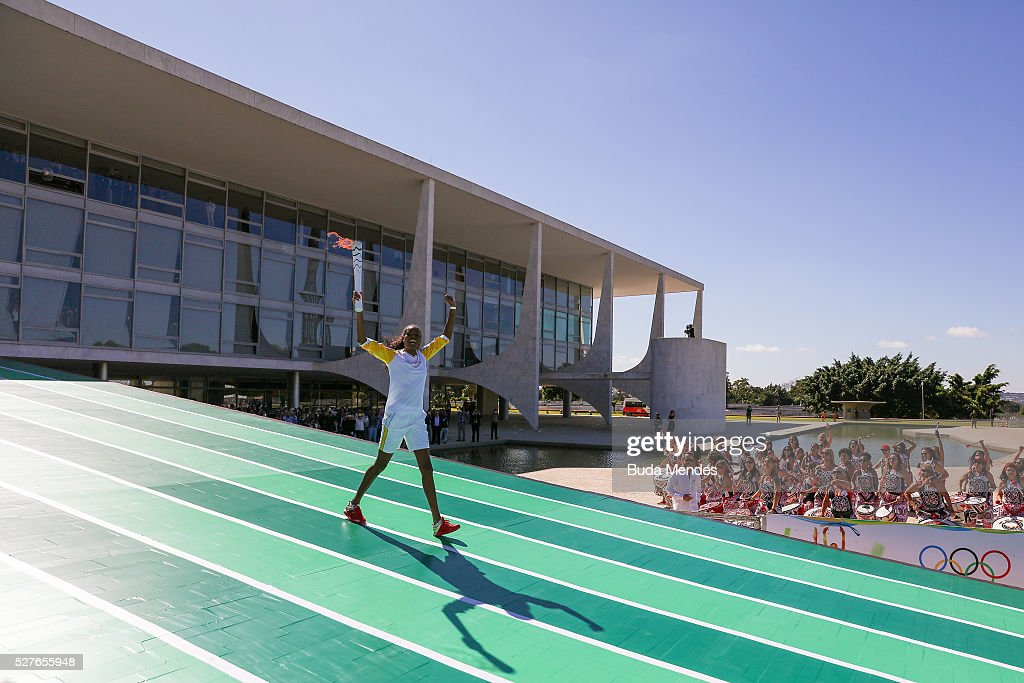 Brazilian volleyball player Fabiana Claudino holds the Olympic torch after receiving it from Brazilian President Dilma Rousseff at Planalto Palace in Brasilia following the flame's arrival in Brazil on May 3, 2016 in Brasilia, Brazil. The Olympic torch will pass through 329 cities from all states from the north to the south of Brazil, until arriving in Rio de Janeiro on August 5, to lit the cauldron.