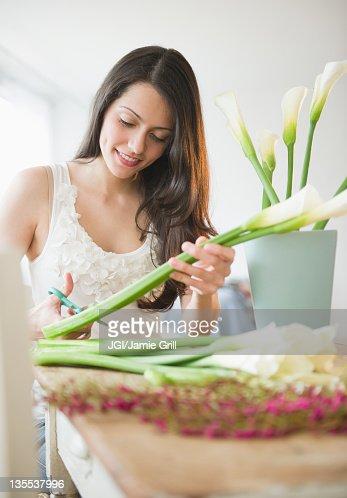 Brazilian woman arranging flowers : Stock Photo