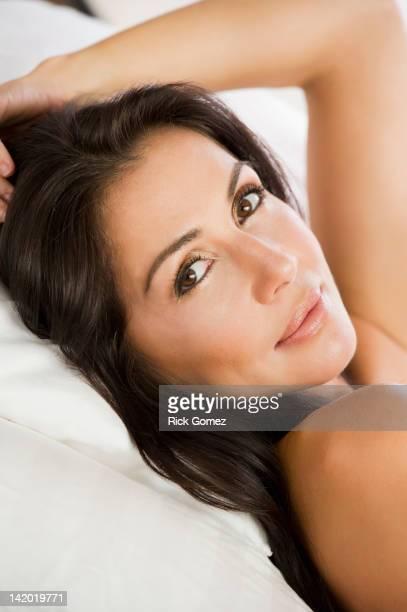 Brazilian woman laying in bed