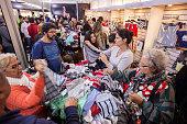 Brazilian women buy underwear on sale 2016 FEVEST Festival in Nova Friburgo Rio de Janeiro State Brazil Fevest is the most important Brazilian fair...