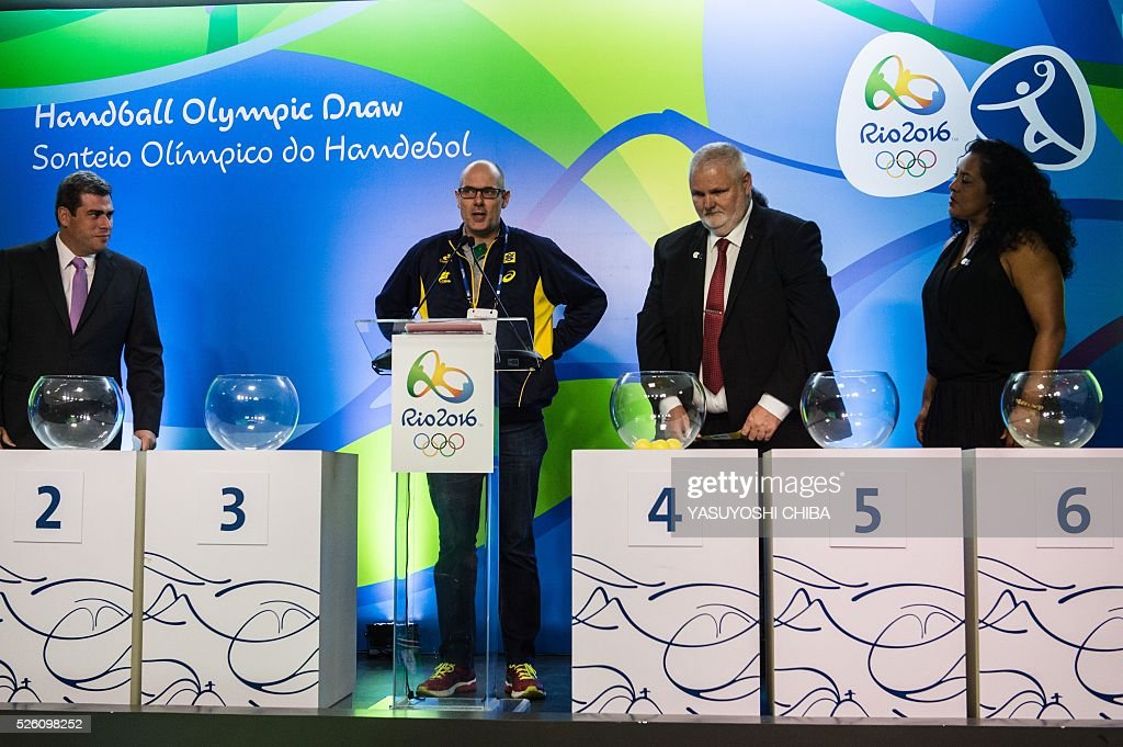 Brazilian women's handball national team Danish coach Morten Soubak (2nd-L) chooses a group during the Handball draw for the Rio 2016 Olympic games at Future Arena of Olympic Park in Rio de Janeiro, Brazil, on April 29, 2016. / AFP / YASUYOSHI