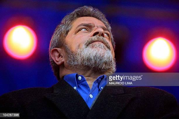 Brazilian Workers' Party Presidential candidate Luiz Inacio Lula da Silva listens to a speech 21 July at the Primero de Mayo Stadium in Sao Bernardo...