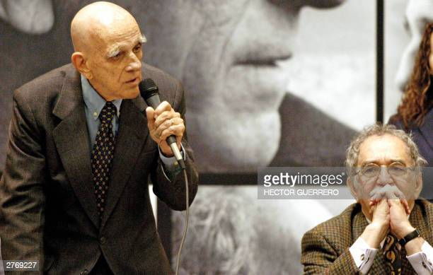 Brazilian writer Rubem Fonseca speaks with the press nex to Colombian Gabriel Garcia Marquez after receiving the 2003 Latin American and Caribbean...