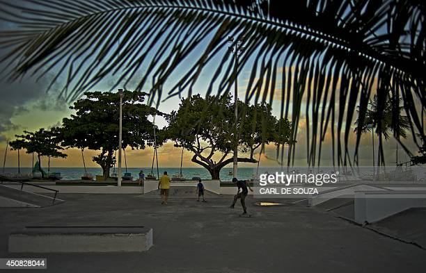 Brazilians are pictured at the beach where the Ghana national football team's base camp is located in Maceio on June 18 2014 Ghana will face Germany...