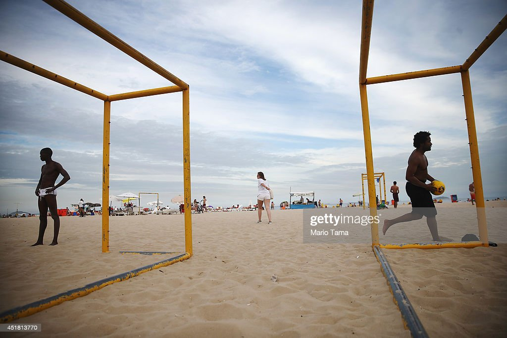 Brazilians gather and play soccer on Copacabana Beach on July 7, 2014 in Rio de Janeiro, Brazil. Brazil plays Germany tomorrow in the first semi-final match of the 2014 FIFA World Cup.