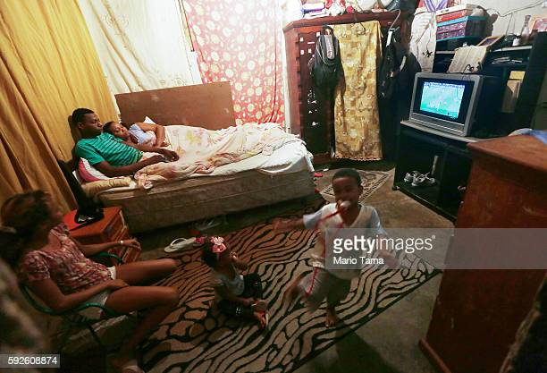 Brazilians gather and watch their team playing Germany in an occupied building in the Mangueira 'favela' community on August 20 2016 in Rio de...