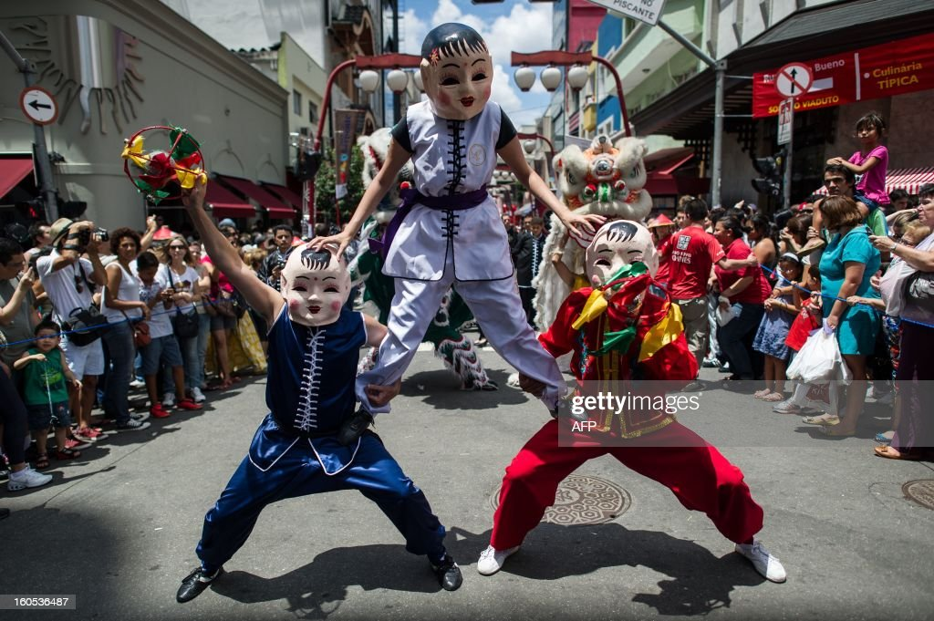 Brazilians in costume take part in the Chinese lunar new year celebrations at Liberdade district in Sao Paulo, Brazil, on February 2, 2013. The Chinese lunar New Year's day will be February 10 as the year of snake in Chinese zodiac calendar. AFP PHOTO/Yasuyoshi CHIBA