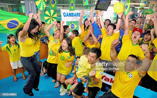 Brazilians living in Japan cheer during the World Cup opening match between Brazil and Croatia on June 13 2014 in Oizumi Gunma Japan