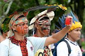 Brazilians natives hold a protest against the new demarcation of indigenous lands bill that is being discussed in Congress after being passed by the...