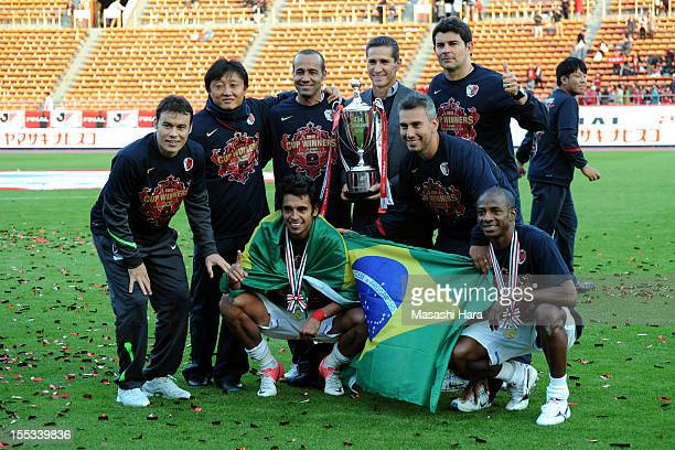 Brazilians of Kashima Antlers pose after the club's victory in the JLeague Yamazaki Nabisco Cup final between Shimizu SPulse and Kashima Antlers at...