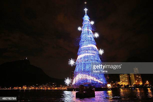 Brazilians paddle past the world's largest floating Christmas tree on December 21 2014 in Rio de Janeiro Brazil The tree is 85meters tall and...
