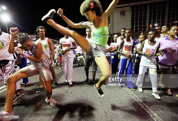 Brazilians perform capoeira on the first day of Carnival celebrations on February 16 2012 in Salvador Brazil Capoeira is a Brazilian martial art and...
