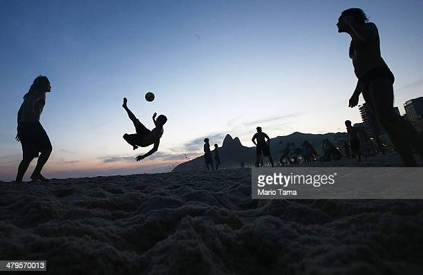 Brazilians play altinha a spinoff of soccer played on the beach on Ipanema Beach on March 19 2014 in Rio de Janeiro Brazil Altinha is Portuguese for...