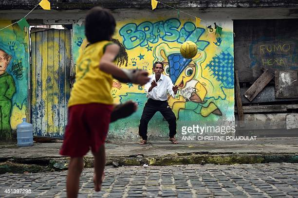 Brazilians play football on June 28 in Porto Seguro during the Round of 16 football match between Brazil and Chile played at the Mineirao Stadium in...