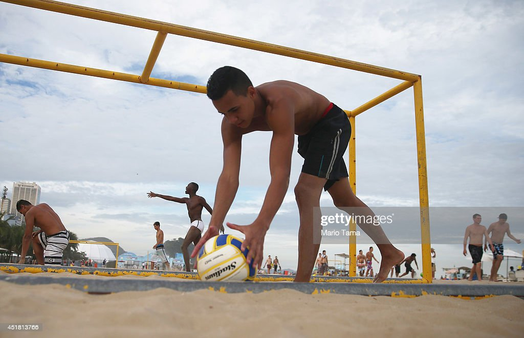 Brazilians play soccer on Copacabana Beach on July 7, 2014 in Rio de Janeiro, Brazil. Brazil plays Germany tomorrow in the first semi-final match of the 2014 FIFA World Cup.
