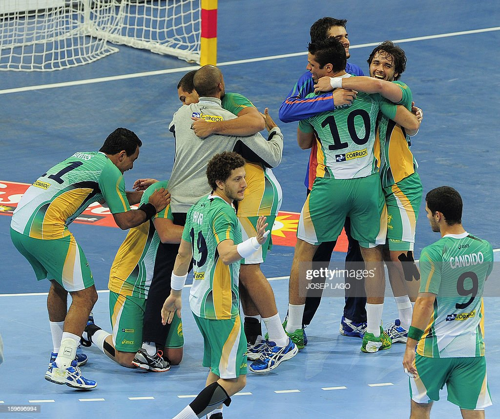 Brazilian's players celebrate after winning Montenegro during the 23rd Men's Handball World Championships preliminary round Group A match Montenegro vs Brazil at the Palau Sant Jordi in Barcelona on January 18, 2013. Brazil won 26-25. AFP PHOTO/ JOSEP LAGO