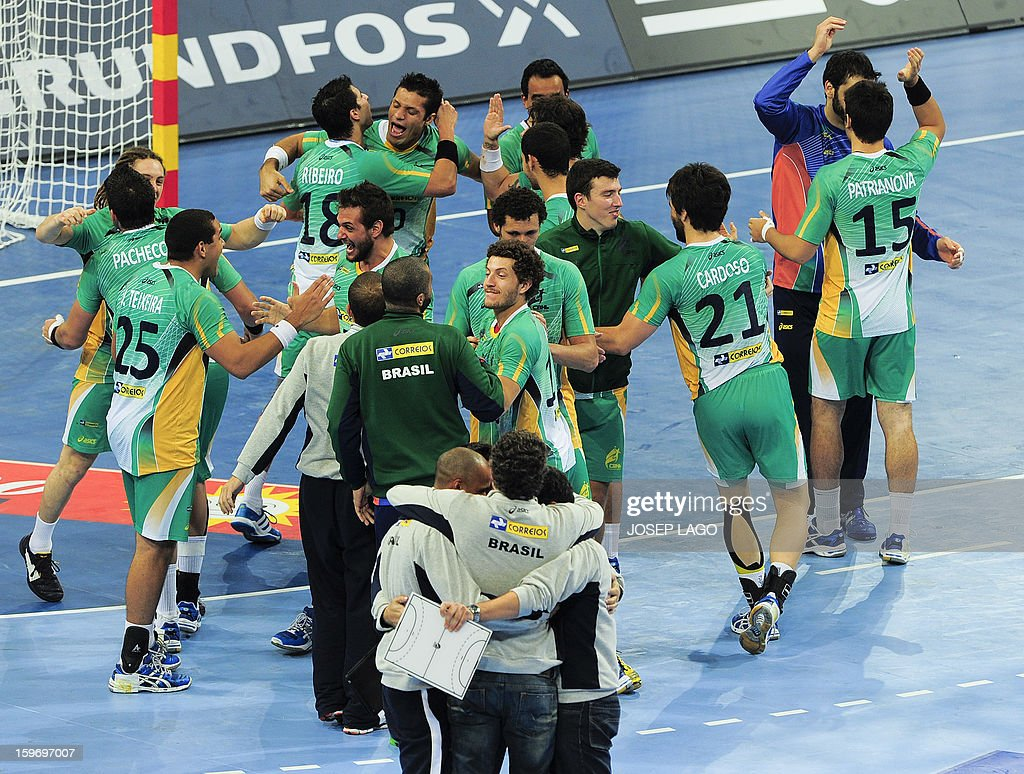 Brazilian's players celebrates after winning the 23rd Men's Handball World Championships preliminary round Group A match Montenegro vs Brazil at the Palau Sant Jordi in Barcelona on January 18, 2013. Brazil won 26-25.