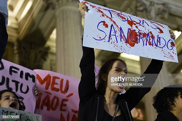 Brazilians protest in front of the Legislative Assembly of Rio de Janeiro on May 27 against a gangrape of a 16yearold girl Brazilian police on Friday...