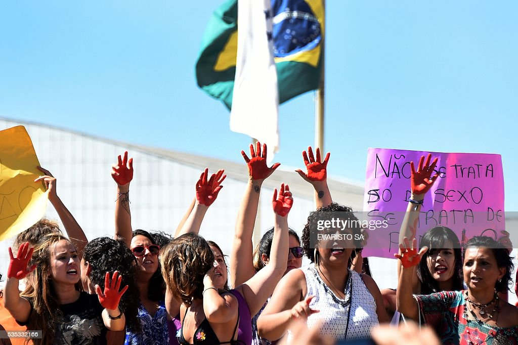 Brazilians protest outside the Supreme Court in Brasilia on May 29, 2016, against the recent gang-rape of a 16-year-old girl. Brazilian police are investigating the gang-rape of a 16-year-old girl, whose attackers posted an online video and photos that triggered global outrage, showing her naked on a bed and the alleged rapists bragging that she had been raped by more than 30 men. / AFP / EVARISTO SA