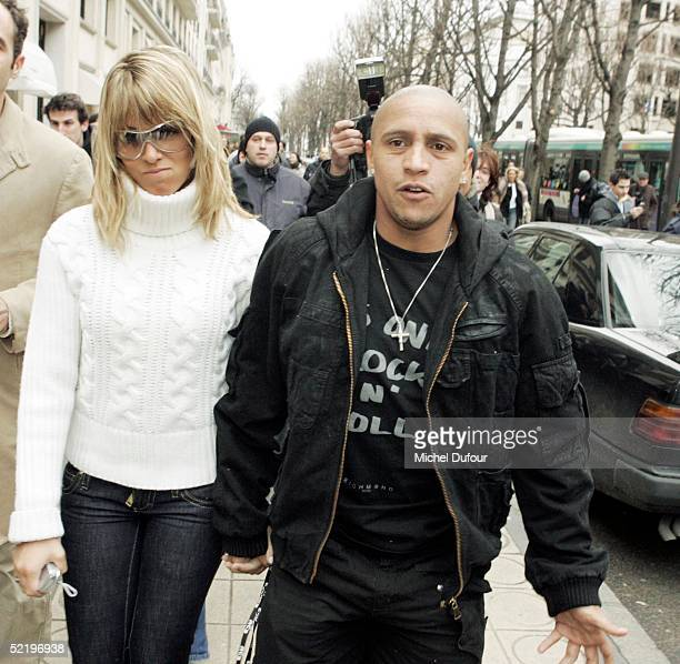 Brazillian footballer Roberto Carlos leaves his Paris hotel The Plaza with a girl to attend Real Madrid teammate Ronaldo's engagement party at...