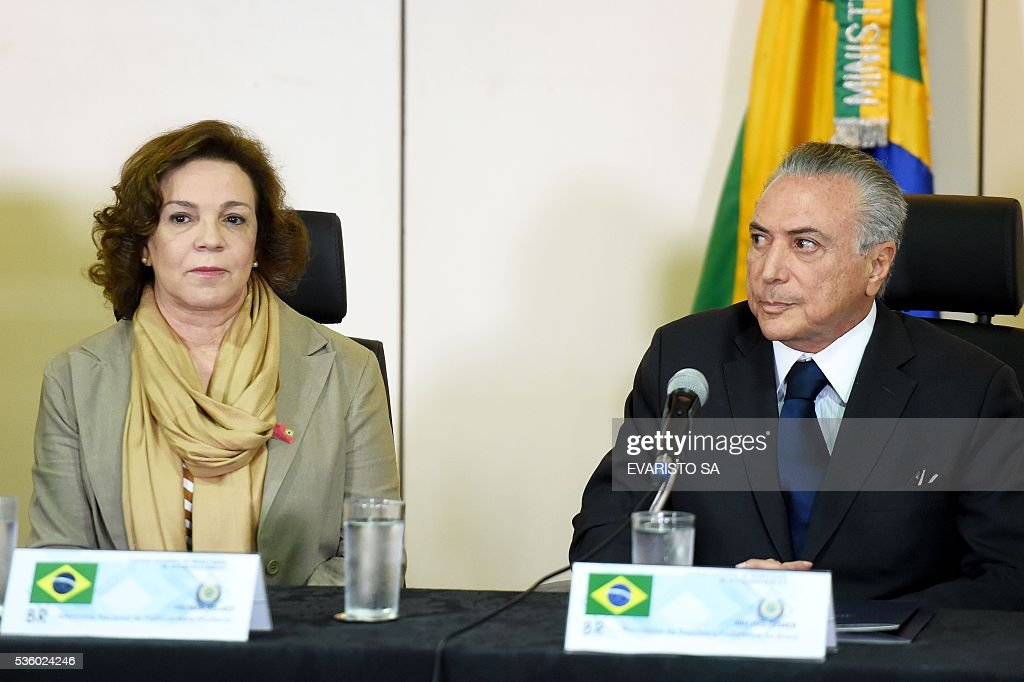 Brazil's acting President Michel Temer (R) and National Secretary of Policy for Women Fatima Pelaes are pictured during a meeting with the secretaries of security of Brazilian states, in Brasilia, on May 31, 2016. Temer proposed a 'joint effort' to 'ban' violence against women following two gang rapes of teenage girls including one in Rio de Janeiro supposedly involving 30 men that was filmed and posted online and that has shocked Brazil. / AFP / EVARISTO SA