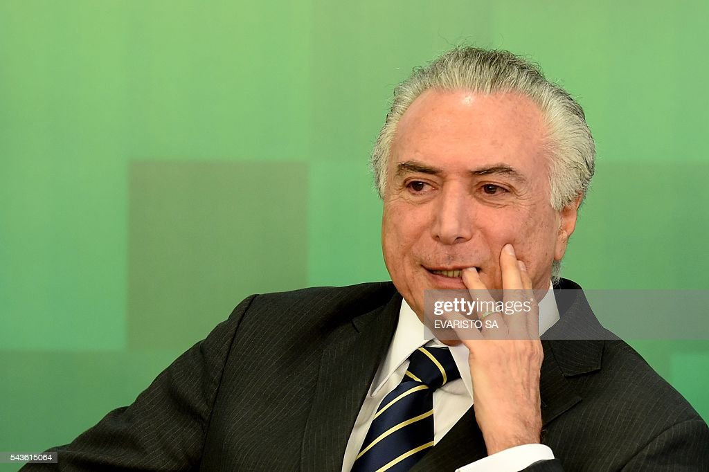 Brazil's acting President Michel Temer attends the ceremony to announce the increase of the Bolsa Familia (Income Distribution Program) and the release of funds for education at the Planalto Palace in Brasilia on June 29, 2016. The government announced an average increase of 12.5% in the Bolsa Familia program, following two years without adjustment. / AFP / EVARISTO SA