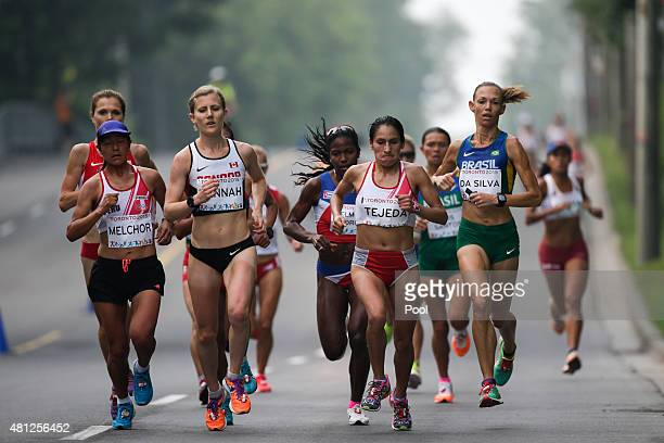 Brazil's Adriana da Silva right Peru's Gladys Tejeda center right Canada's Rachel Hannah center left Peru's Ines Melchor left and other athletes run...
