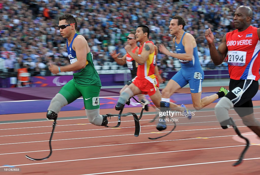 Brazil's Alan Fonteles Cardoso Oliveira (L) competes in the men's 100m T44 round 1, heat 1 during the athletics competition at the London 2012 Paralympic Games at the Olympic Stadium in east London on September 5, 2012.