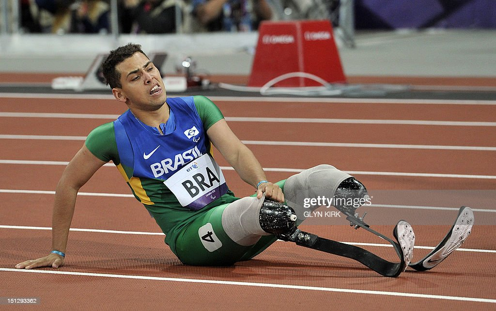 Brazil's Alan Fonteles Cardoso Oliveira sits on the track at the end of the men's 4x100 metres relay T42-46 final during the athletics competition at the London 2012 Paralympic Games at the Olympic Stadium in east London on September 5, 2012. The team from Brazil were disqualified.