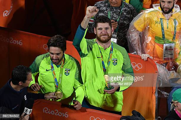 Brazil's Alison Cerutti and Bruno Bruno Oscar Schmidt after winning the gold medal in the men's beach volleyball final match between Italy and Brazil...