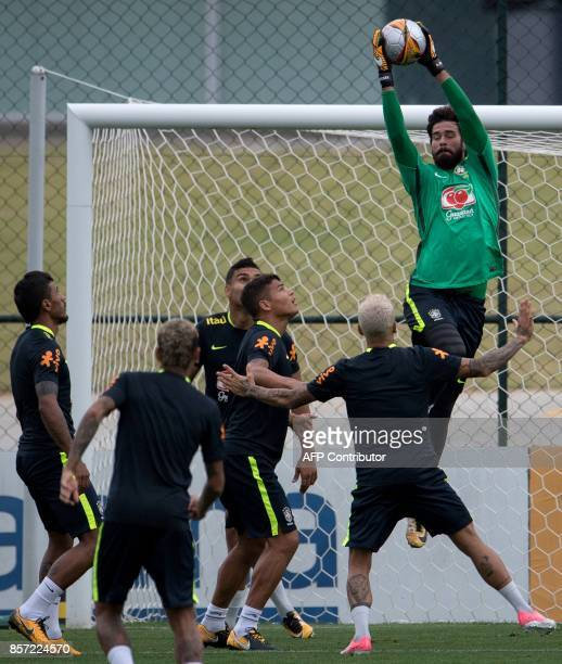 Brazil's Alisson grabs the ball during a training session at the Granja Comary sports complex in Teresopolis about 90 km from Rio de Janeiro Brazil...