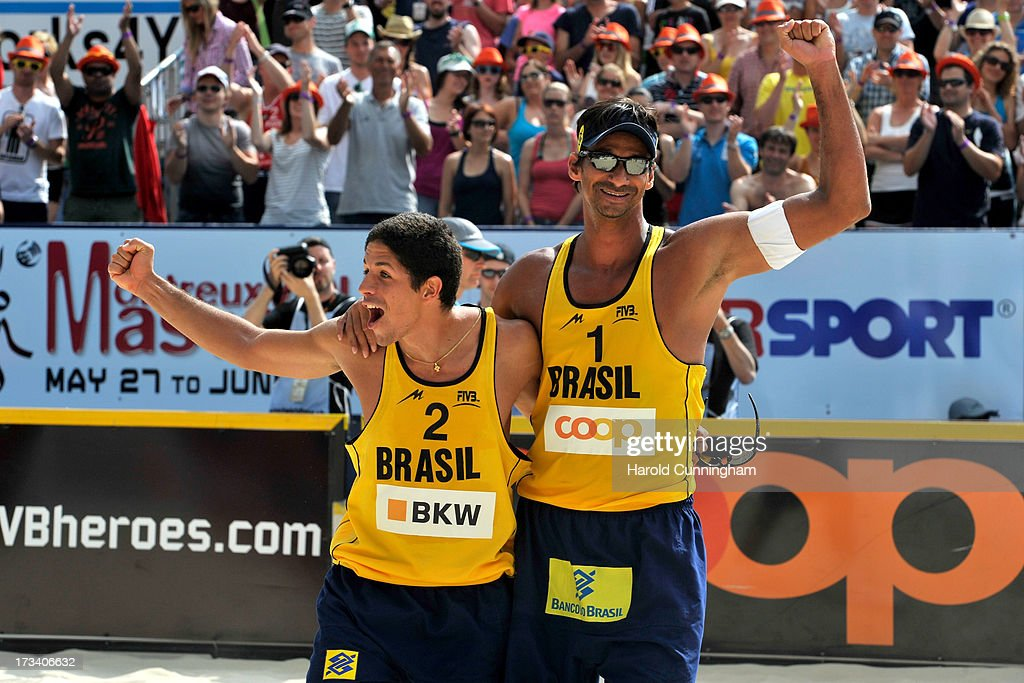 Brazil's Alvaro Filho and Ricardo Santos celebrate their victory after the Ricardo-Alvaro Filho v Brouwer-Meeuwsen semi-finals match as part of the FIVB Gstaad Grand Slam fifth day on July 13, 2013 in Gstaad, Switzerland.