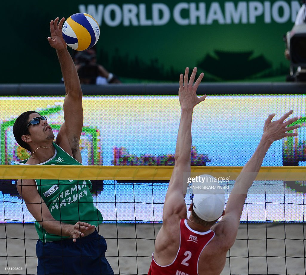 Brazil's Alvaro Morais Filho (L) spikes a ball against Netherland's Robert Meeuwsen (R) during the final match of the Beach Volleyball World Championships on July 7, 2013 in Stare Jablonki, Poland.