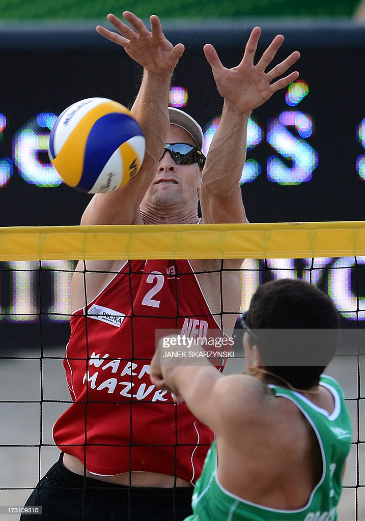 Brazil's Alvaro Morais Filho (R) spikes a ball against Netherland's Robert Meeuwsen (L) during the final match of the Beach Volleyball World Championships on July 7, 2013 in Stare Jablonki, Poland.