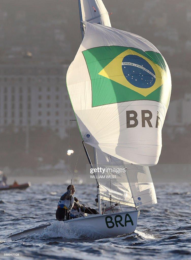 Brazil's Ana Luiza Barbachan and Brazil's Fernanda Oliveira compete in the 470 Women sailing class on Guanabara Bay in Rio de Janerio during the Rio...