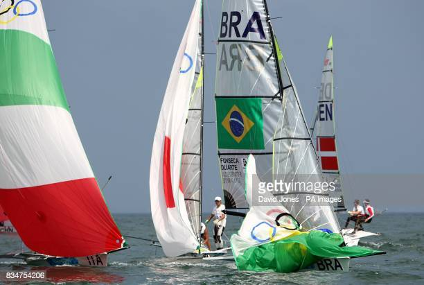 Brazil's Andre Fonseca and Rodrigo Duarte adjust their spinnaker during the opening rounds at the 2008 Beijing Olympic Games' sailing centre at...