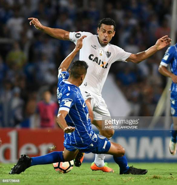 Brazil's Atletico Mineiro Fred vies for the ball with Walter Serrano of Argentina's Godoy Cruz during their Copa Libertadores 2017 football match at...