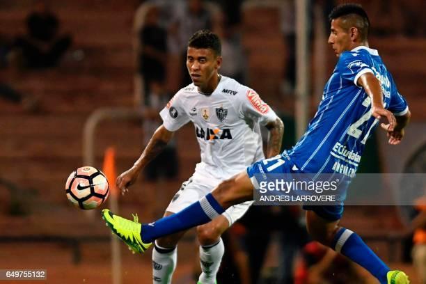 Brazil's Atletico Mineiro Marcos Rocha vies for the ball with Fabricio Angileri of Argentina's Godoy Cruz during their Copa Libertadores football...